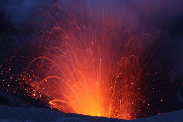 Mount Yasur erupts at dusk