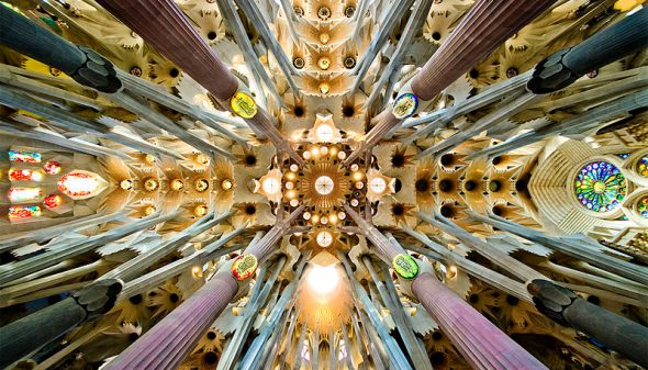 Sagrada Familia nave roof detail by SBA73, licensed under CC BY-SA 2.0 via Wikimedia Commons
