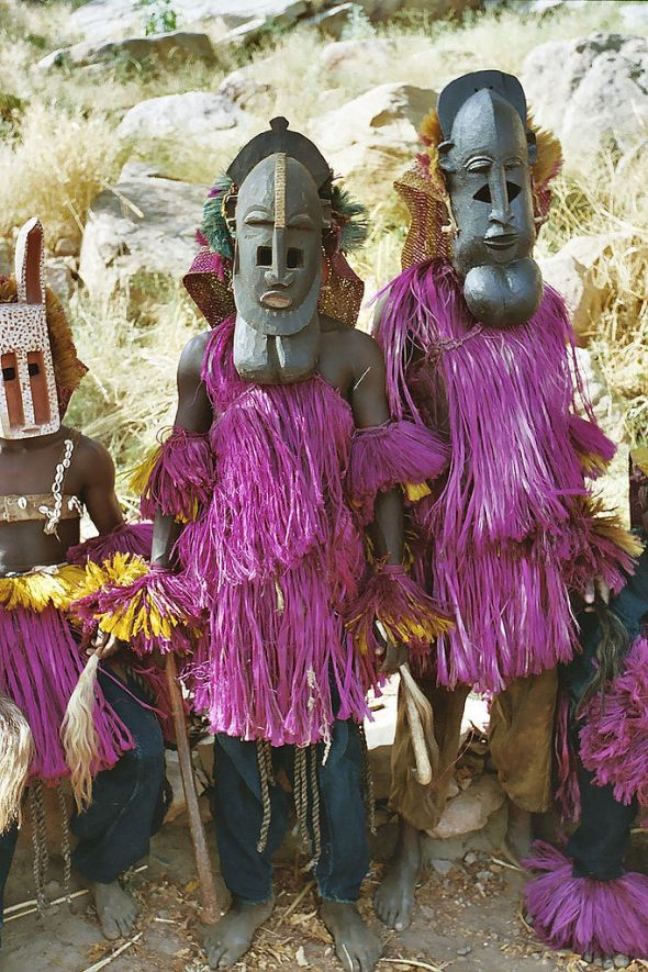 Dogon masked dancers by Devriese reproduced under the terms of the Creative Commons Licence CC BY 3.0
