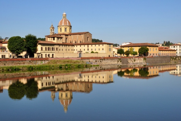 Perfect reflections on the still water, River Arno