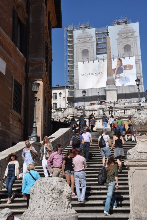 At the Spanish Steps it's business as usual, but its pretty church, Trinità dei Monti, is currently covered up.