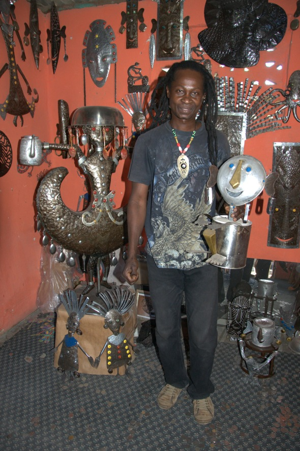 Jacques Eugene in Croix des Bouquets, Haiti, with his amazing metalwork pieces