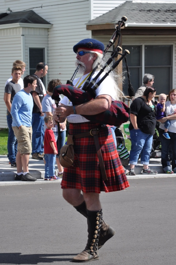 The parade is led by a piper