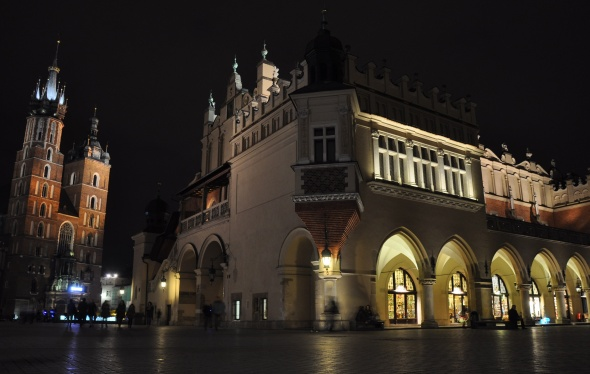 The twin towers of St Wojciech's church next to the Renaissance-era Cloth Hall