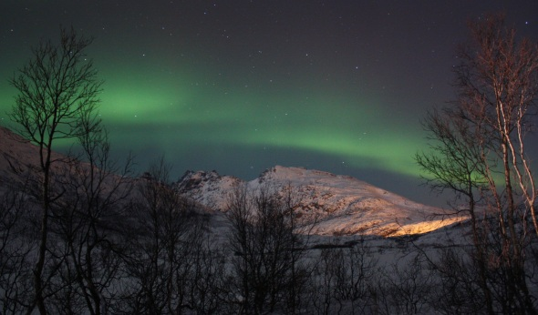 Northern Lights over the hills surrounding Tromso