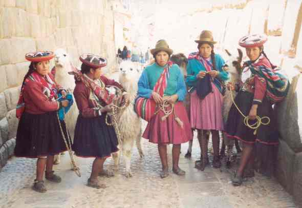 Peru Llama girls and Inca stonework